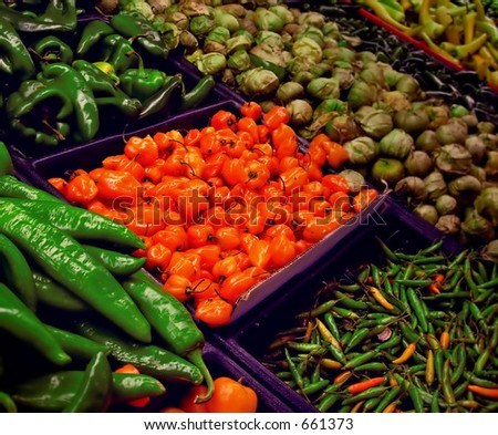 Assorted peppers in supermarket display - stock photo
