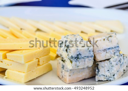assorted pieces or slices of asturian cheeses. dairy delicatessen. Cabrales, blue cheese