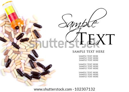 Assorted pills or medicine spilling out of a prescription bottle on white background - stock photo