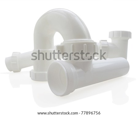 Assorted PVC accessory pieces - stock photo