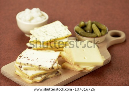 Assorted Raclette cheeses - stock photo