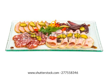 Assorted sausages sliced and served as appetizer - stock photo