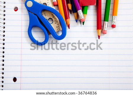 Assorted school supplies with a notebooks, pencils, pens, scissors etc. - stock photo
