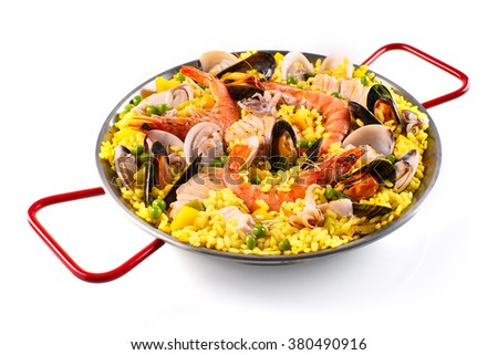 Assorted shellfish and mussels cooked with rice for a delicious paella margarita recipe - stock photo