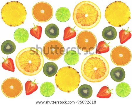 Assorted sliced fruit on a white background. - stock photo