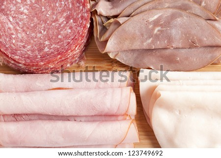 Assorted sliced meat in a macro image - stock photo