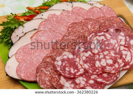 assorted sliced sausages close up - stock photo