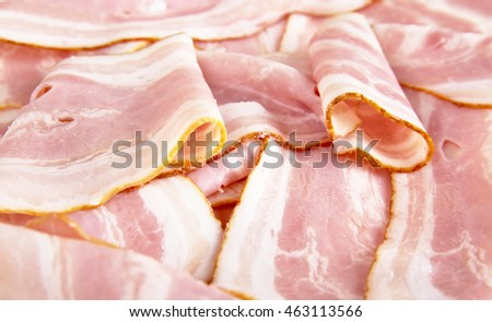 Assorted slices of fat pink bacon background