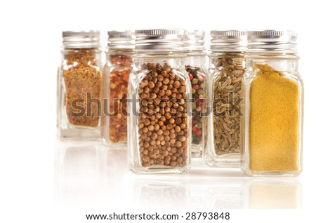 Assorted spice jars isolated on white background - stock photo