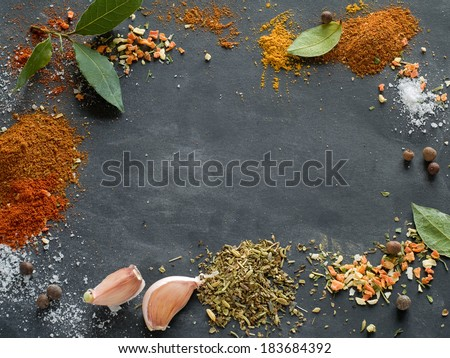 Assorted spices on blackboard background, selective focus  - stock photo