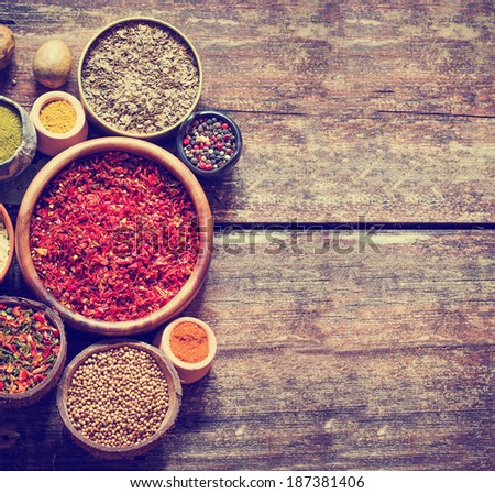 Assorted spices on wooden background  in rustic style - stock photo