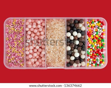 Assorted sugar cake sprinkles, decorations - stock photo
