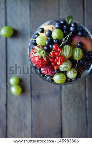 Assorted summer berries in a bowl, top view, food - stock photo