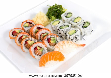 Assorted sushi dish on a white square dish - stock photo