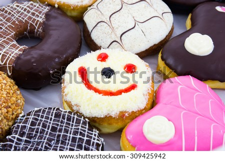 Assorted sweet donuts  - stock photo