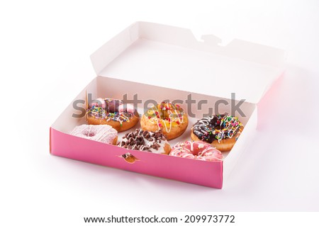 Assorted sweet donuts in a paper box - stock photo