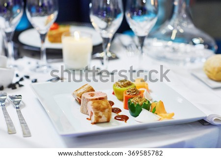 Assorted tasty finger food on a wedding reception - stock photo