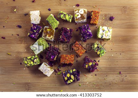 Assorted Turkish Delights on wooden background. Sugar coated soft candy - stock photo