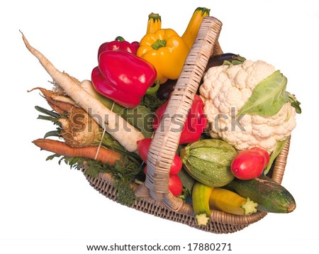 Assorted vegetables in a wicker basket.