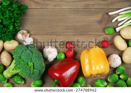 Assorted vegetables on rustic wooden background. Top view point. - stock photo