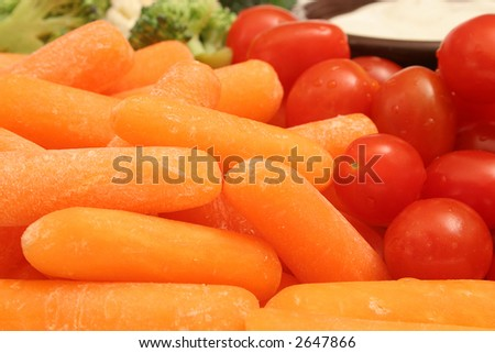 assorted vegetables w/dip background - stock photo