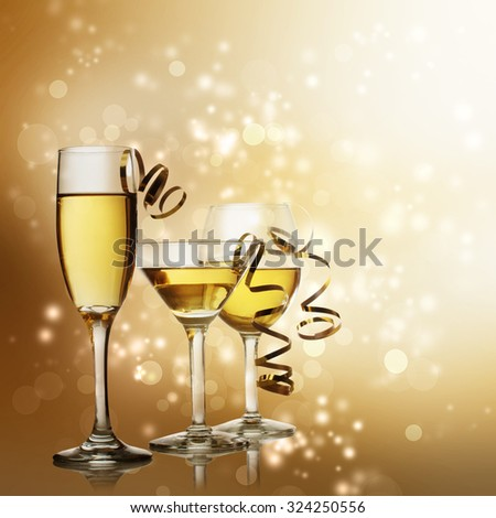 Assorted Wine, Champagne and Cocktail Glasses on a Sparkling Gold  Backdrop - stock photo