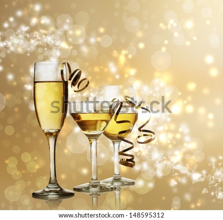 Assorted Wine, Champagne and Coctail Glasses on a Sparkling Gold  Backdrop - stock photo