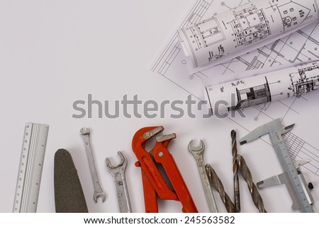 assorted work tools and plans - stock photo