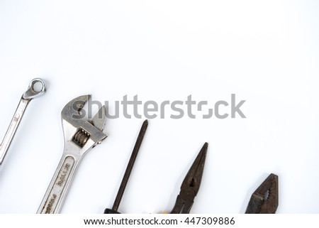 Assorted work tools on white background for copy space - stock photo