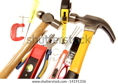 Assorted work tools over white