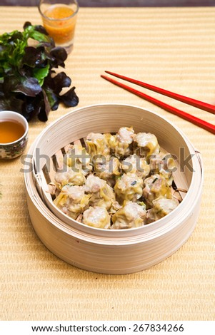 assortment dim-sum / Chinese Steamed shrimp dumplings dimsum in bamboo containers traditional cuisine. - stock photo