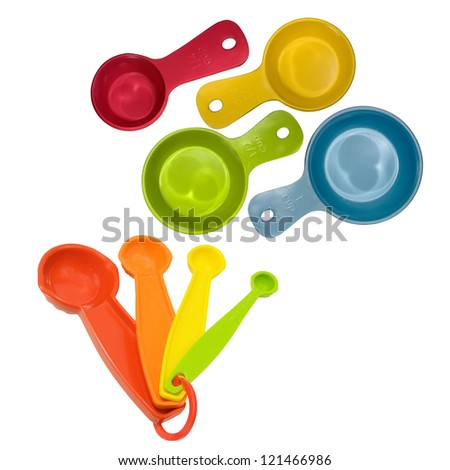 assortment measuring cups and spoons for baking or cooking on a white background - stock photo