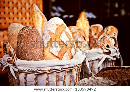 Assortment of baked bread in baskets - stock photo