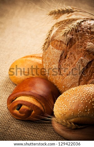 assortment of baked bread on burlap