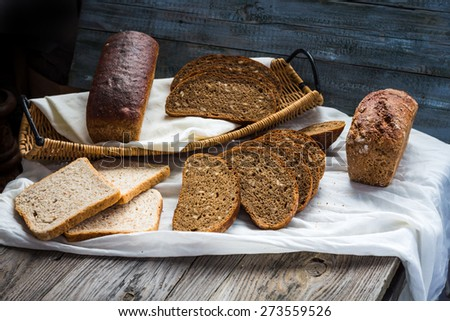 assortment of baked bread, slices of rye bread, bran cereal, rustic