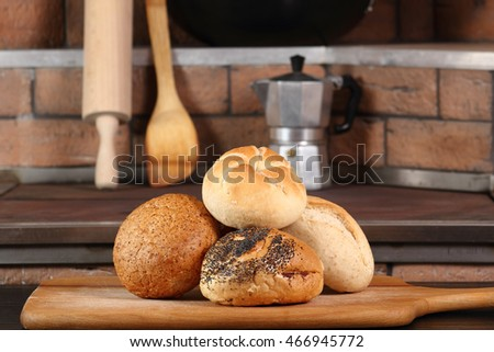 Assortment of bread rolls at rural kitchen background