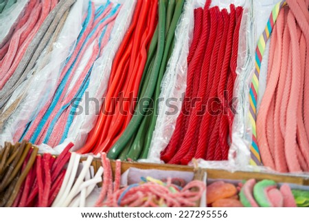 assortment of candies of different flavors and colors - stock photo