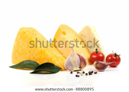 Assortment  of cheese  and some spice on a white background - stock photo