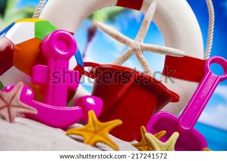 Assortment of children's beach toys - stock photo