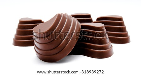 Assortment of chocolate candies isolated on a white background
