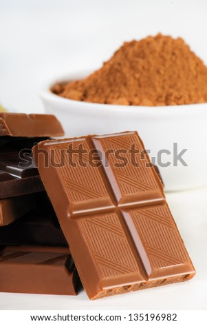 Assortment of chocolates on white - stock photo