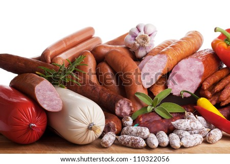Assortment of cold meats, variety of processed cold meat products. - stock photo