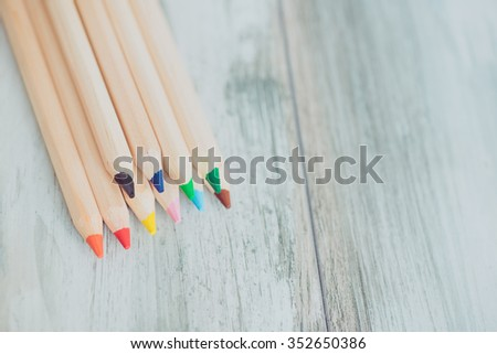 Assortment of colored pencils/Colored Drawing Pencils/Colored drawing pencils in a variety of colors on vintage wooden background - stock photo