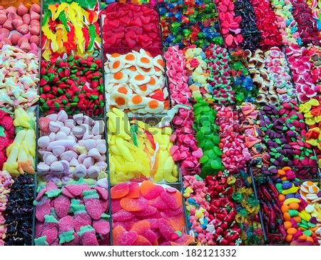 assortment of colorful candy on background with jellybeans - stock photo