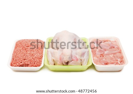 Assortment of crude meat in trays isolated - stock photo