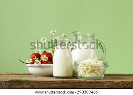 assortment of dairy products (milk, butter, sour cream, yogurt) rustic still life - stock photo