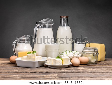 Assortment of dairy products on vintage wooden table - stock photo