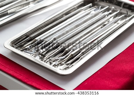 Assortment of dental instruments and probes made of steel on a tray - stock photo