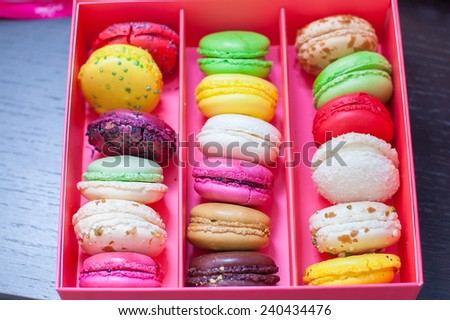 Assortment of different colored macaroons in pink box  - stock photo