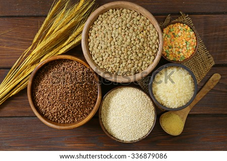 assortment of different grains - buckwheat, rice, lentils, quinoa - stock photo